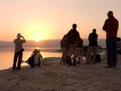 Filming the sunrise at the Dead Sea